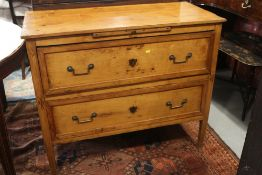 A 19th century French provincial fruitwood commode, fitted slide over two drawers, on square taper
