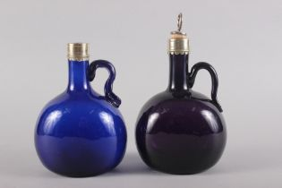 "An amethyst glass and metal mounted bottle with stopper, 7"" high, and another similar smaller blue"