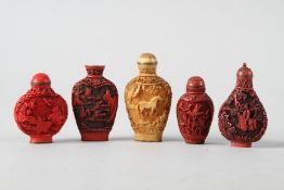 """Four Chinese cinnabar lacquered snuff bottles and another similar snuff bottle, largest 2 3/4"""" high"""
