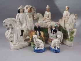 A pair of Staffordshire flat back figures of Lord Kitchener and General Gordon, and five other