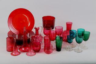 Nine Georgian ruby glass plates, a similar wine glass cooler, three trumpet glasses, five green