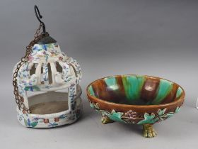 """A majolica shallow fruit bowl, on paw feet, 10 1/2"""" dia, and a Chinese pottery birdcage"""
