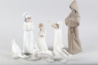 """A Lladro brown bisque figure of a bearded monk, 2060, 13"""" high, a Lladro figure of a boy with"""