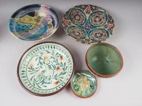 An assortment of studio pottery dishes, a Winstanley seated cat ornament, etc
