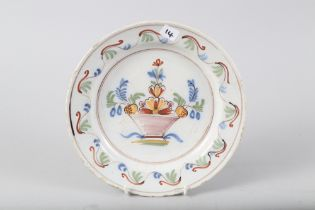 """A French early 19th century faience polychrome plate with vase of flower design, 9"""" dia ("""