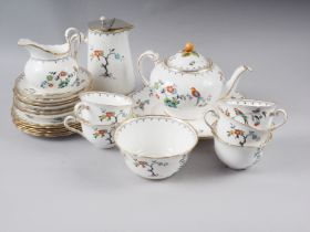 """A Tuscan china """"Plant"""" pattern teaset, manufactured for Harrods (missing one teacup)"""
