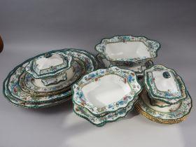 "A Doulton Burslem ""Elaine"" pattern part dinner service, including a turkey platter, tureens, plates,"