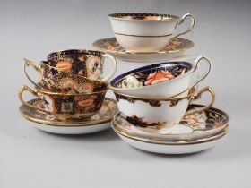 Six Royal Crown Derby cups and saucers, various patterns