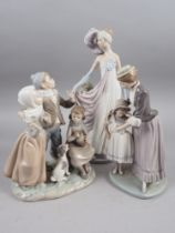 """Three Lladro figures comprising a 1920s woman, 13 1/2"""" high, three singing children and a mother"""