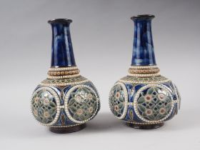 """A pair of Royal Doulton blue and green glazed bottle vases, 9"""" high, and a pair of Doulton"""