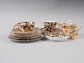 A pair of Royal Crown Derby cups, pattern 2451, six matching saucers, a similar pin dish and a
