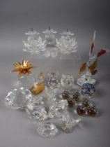 A collection of Swarovski crystal, including a triple pricket candlestick, a gilt metal mounted