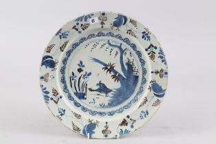 """An early 18th century Bristol blue and manganese charger with bird and fence design, 13 1/2"""" dia,"""