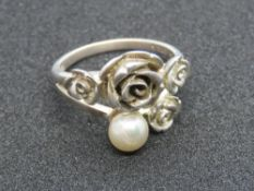 A silver Folli Follie ring having floral design with single pearl, stamped Folli Follie with 925,