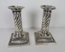 A pair of HM silver Victorian short candlesticks each having square shaped base with twist