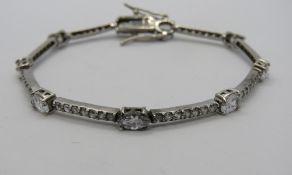A HM silver bracelet set with white stones, hallmarked 925.