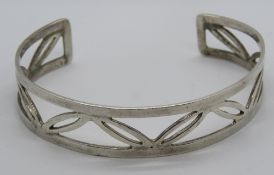 A HM silver bangle having open leaf pattern, 15mm wide, hallmarked 925 and further stamped 925.