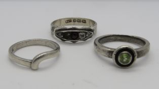 Three silver rings; one hallmarked silver set with five stones, size Q,