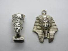 A silver charm in the form of Nefertiti Egyptian Queen and another white metal charm or pendant in