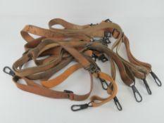 Nine WWII MG42 leather slings.