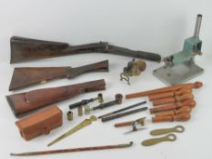 A quantity of assorted militaria items inc, rifle stocks, loader press, gauge kits, ammo case,