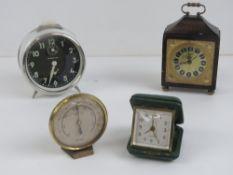 A quantity of assorted alarm clock, trav