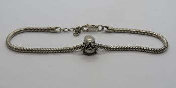A Pandora style charm bracelet stamped 9