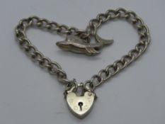 A silver charm bracelet having hallmarke