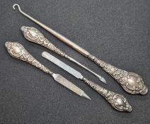 A set of three HM silver handled manicure tools together with a similar HM silver handles button