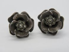 A pair of silver and marcasite floral st
