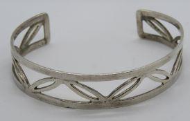 A HM silver bangle having open leaf patt