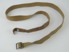 A tropical issue gas mask canister strap