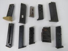 Ten assorted pistol magazines, one being