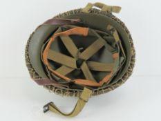 A WWII US Army McCord helmet having heat