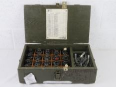 A box containing a quantity of twenty inert F1 Limonka grenades with pins and fuses.