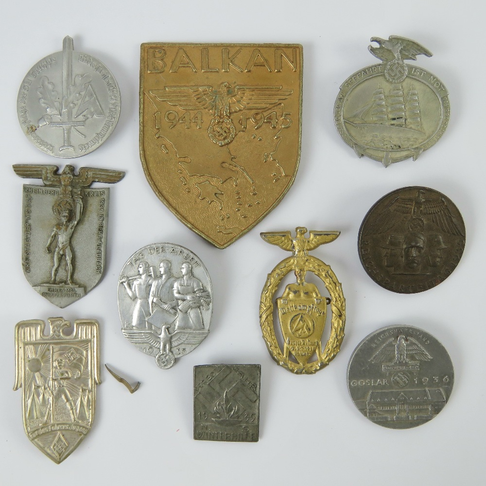 A quantity of assorted WWII German day badges including; Balkan 1944 - 1945, Seefahrt 1st Not,
