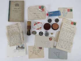 A quantity of Royal Navy ephemera including; first aid book dated 1943, tooth soap, shaving brush,