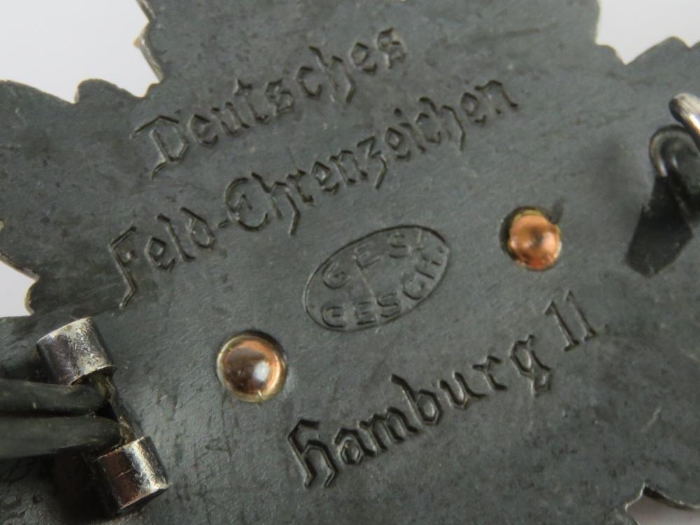 A WWI German Deutsches Feld-EhrenZeichen badge having white enamel cross to front, - Image 3 of 3