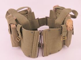 Four US BAR un-issued magazines in canvas pouch.