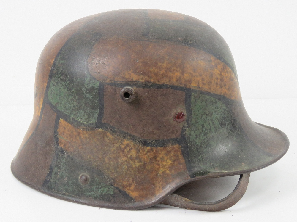 A WWI German M1916 snipers camouflage helmet having E.T.