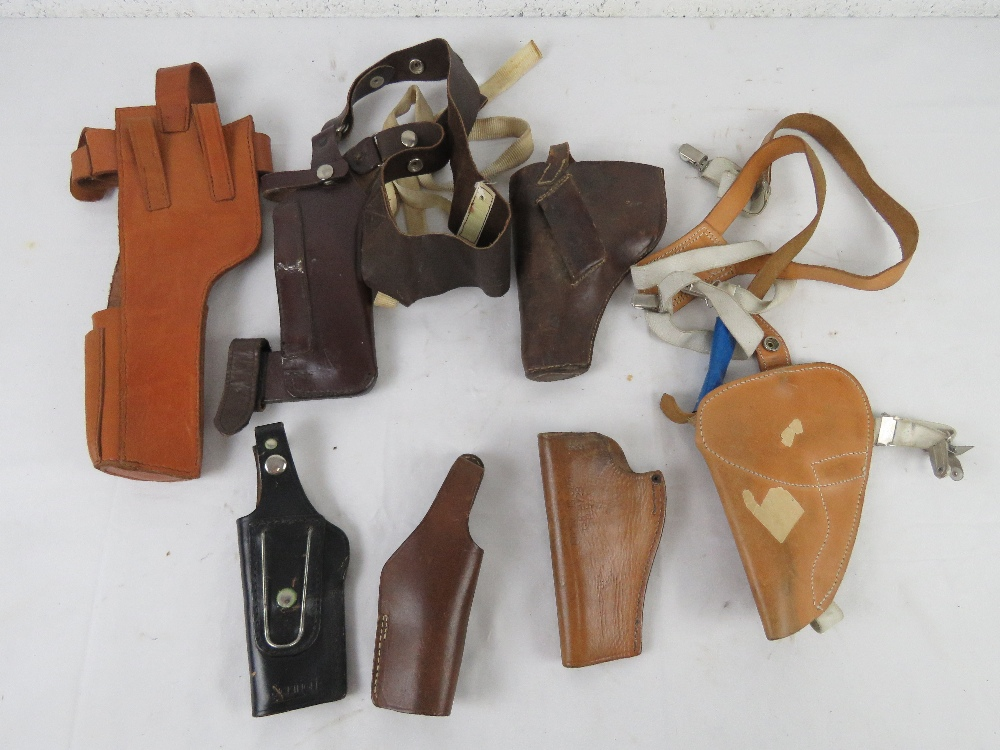 A quantity of seven holsters including a Broomhandle mauser, a colt pythan, s&w, - Image 2 of 4