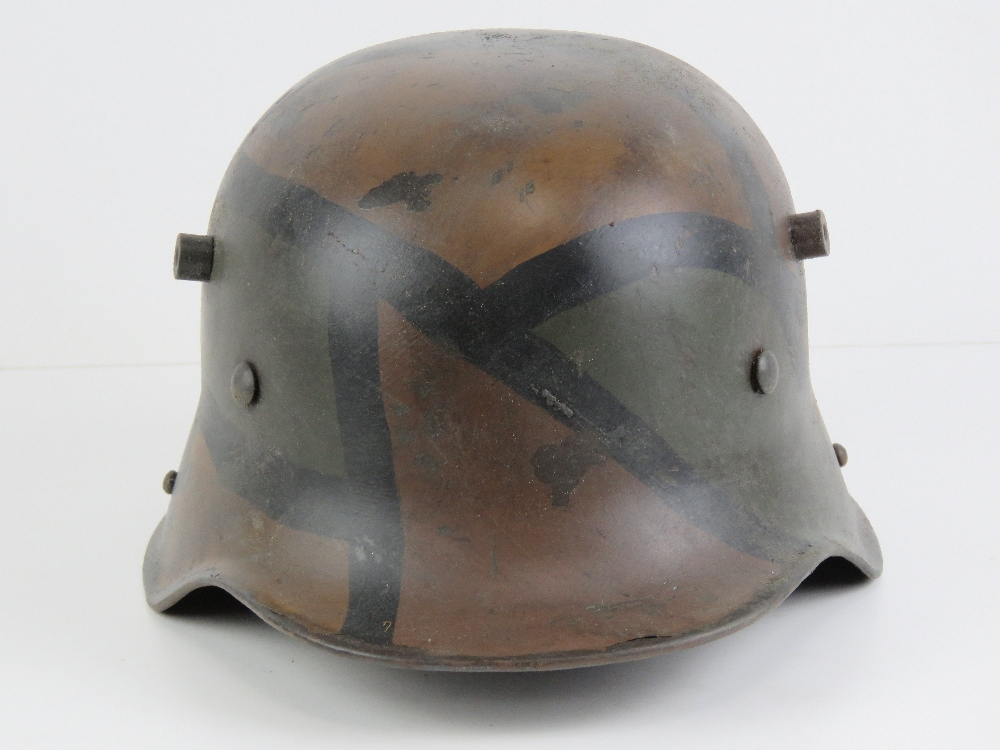 A reproduction WWI German helmet in camouflage paint, with liner. - Image 2 of 6