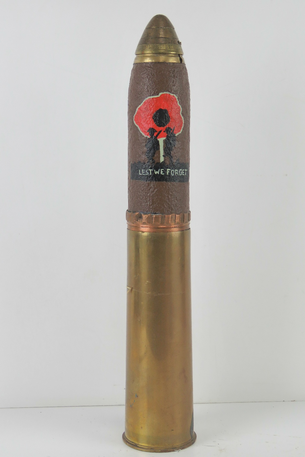 A WWI Canadian HE explosive 18pr dated 1916, the head bearing 'Lest we Forget' poppy trench art.