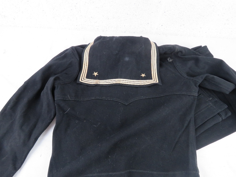 A quantity of US Navy uniform including tunic, sailors top with neck tie, shirt and trousers. - Image 4 of 7