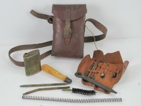 A WWII German MP34 gunners kit in brown leather pouch with strap.