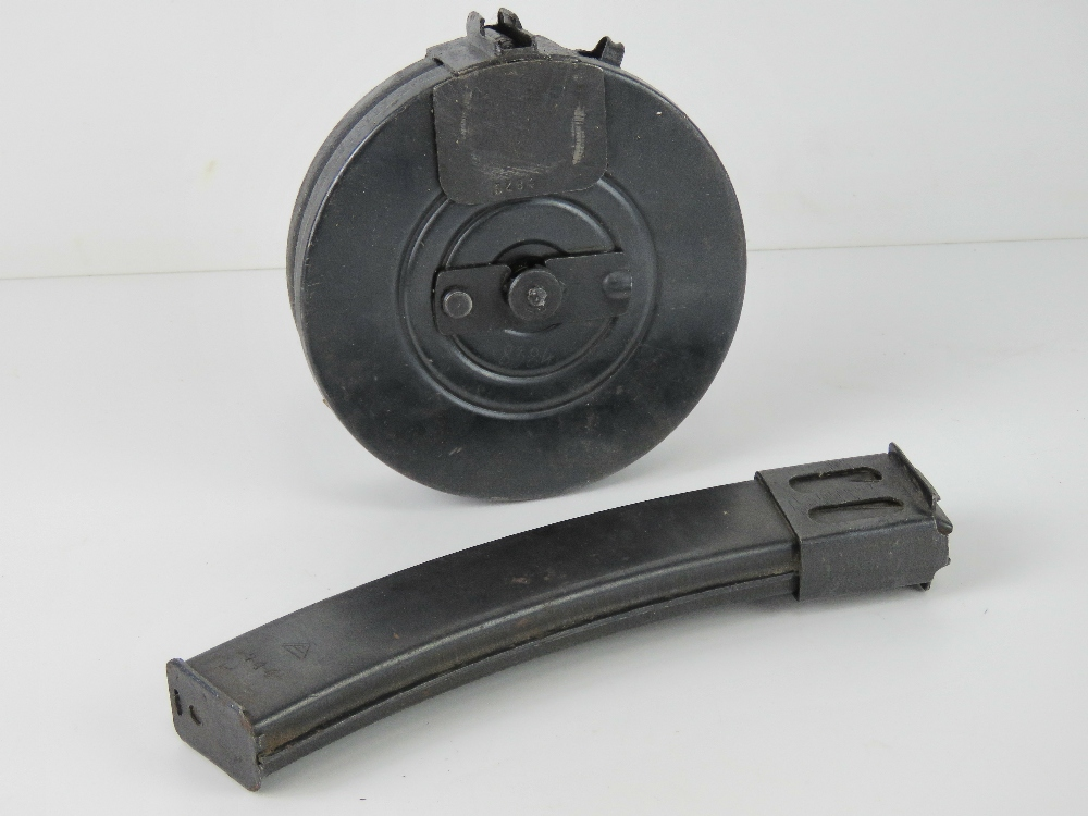 A PPSH-41 drum magazine together with a PPS-43 stick magazine. Two items.