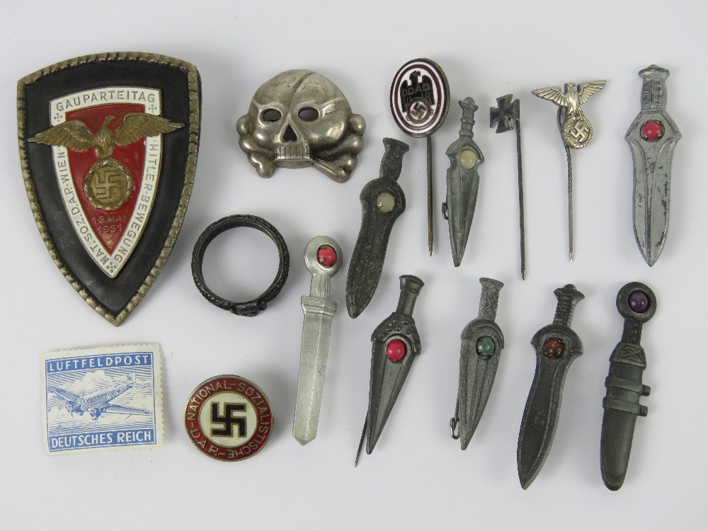 A quantity of assorted re enactor's German badges inc miniature swords, reproduction day badge,