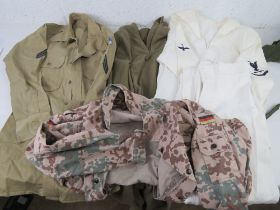 A German top, Navy shirt and trousers, also an army shirt and fleece, water bottle, army side cap,