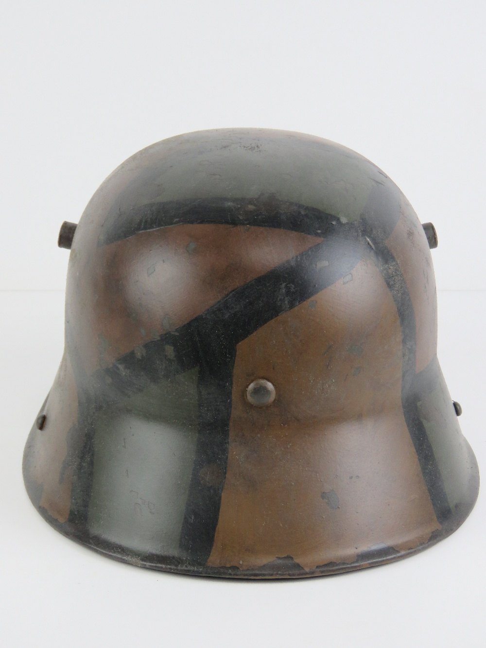 A reproduction WWI German helmet in camouflage paint, with liner. - Image 3 of 6