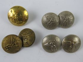 An unusual brass button by Gaunt London having man with flaming torch at waterside.